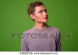 young asian man wearing makeup