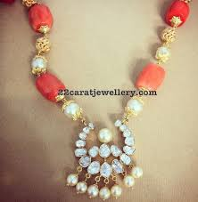 c beads set with diamond pendant