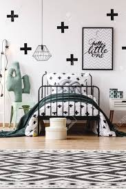 Black And White Geometric Carpet In Kids Room With Toy On Chair Stock Photo Picture And Royalty Free Image Image 85076002