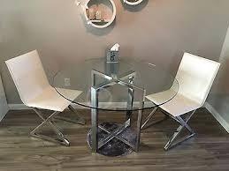cb2 silverado chrome round dining table