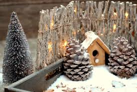 Premium Photo Christmas Decoration Close Up Birdhouse Cones And Fence With Light Bulbs