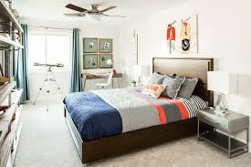 Silver Night Stands Book Shelves Boy S Bedding Boy S Bedroom Comforter Ceiling Fan Cork Board Kid S Bedroom Room Wall Art Decor Metal Pipe Pipes