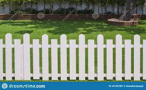 Front View Of White Wooden Fence In Front Of Artificial Turf With Green Plant Growing On Interlocking Brick Blocks In Front Yard Stock Image Image Of Boundary Front 181407987