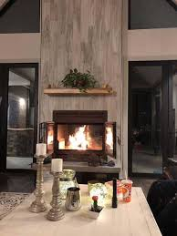 two sided indoor outdoor wood fireplace