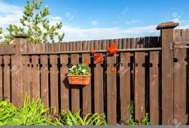 Flower Pot With Decorative Flowers Hanging On The Wooden Fence Stock Photo Picture And Royalty Free Image Image 103792170