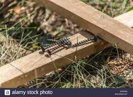 Several Self Tapping Screws On Wooden Boards Construction Assembly Of Wooden Fence Stock Photo Alamy