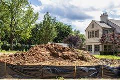 Construction Pile Of Dirt In Vacant Lot Behind Black Plastic Fence In Upscale Neighborhood With Parts Of Adjacent Houses And Stock Image Image Of Area Load 151088237