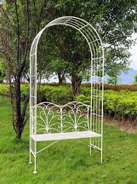 pretty iron arch with seat for garden