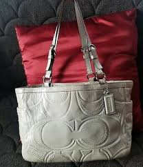 white patent leather purse designer