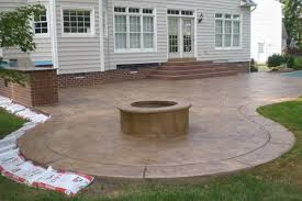 stamped concrete patio firepit and