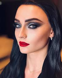 sophie turner as morticia addams with