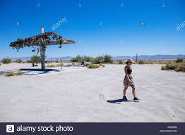 Woman Walking Away From Old Shoe Fence On Demolished Gas Station On Highway 62 Rice California Usa Stock Photo Alamy