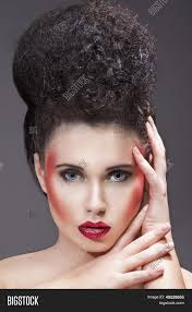beauty makeup with red glitter lips