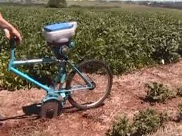 manual seeding with a bike planter
