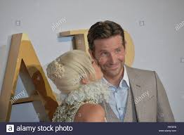 Lady Gaga kisses Bradley Cooper, at the London film premier of A Star is  Born Stock Photo - Alamy