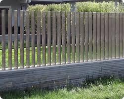 Block With Stone Veneer Wall With Stainless Steel Slats Make A Great Fence For The Modern Home T Post Fence Reta Modern Fence Design Fence Design Modern Fence