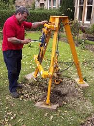 Tree Stump Lifter Hire And Rent Hire Hedge And Tree Pruning Sawing And Cutting With Tool Hire In Edinburgh Glasgow And Midlothians From Martin Plant Hire