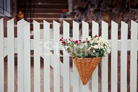 White Fence With Basket Of Flowers Stock Photos Freeimages Com