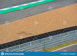 Crash Barrier With Pebbles Asphalt Road Circuit And Safety Fence On Race Track Race Track Construction Kit Stock Photo Image Of Racing Black 127609922