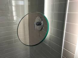 a cut out in the glass shower door to