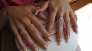 show her long clear nails and scratch
