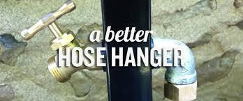 an outdoor pole mounted hose hanger