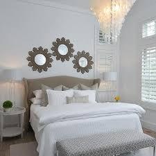 3 sunburst mirrors over bed design ideas