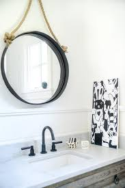 convex mirror with gray wood washstand