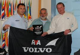 RYA High Performance Manager Chris Blackburn, Chester Sailing Club's Peter  Hadfield and club Commodore Mike Kneale as they are awarded Volvo Champion  Club status