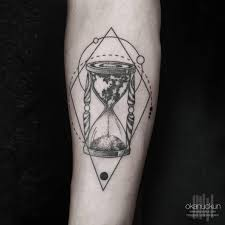 worldly hourglass tattoo by okan uckun