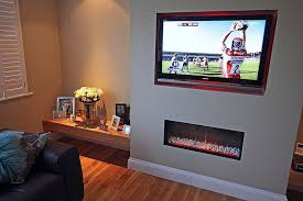 fireplace with built in tv accent wall