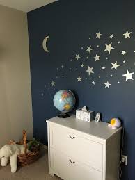 Child S Bedroom With Dark Blue Wall And Silver Stars And Moon Blue Boys Bedroom Dark Blue Rooms Toddler Boys Room