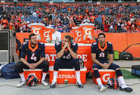 Britton Colquitt-punter; Aaron Brewer-long snapper and Brandon ...