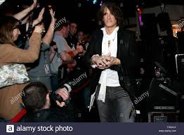 Joe Perry of the band Aerosmith heads towards the stage before playing a  set with his