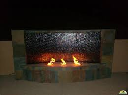 outdoor linear fireplace and water
