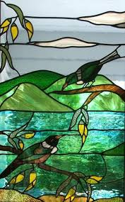 native tui and kowhai in stained glass