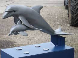 leaping dolphins outdoor statues
