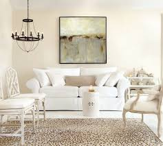 white living room with leopard rug and