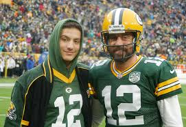 Mostafa spends the day with Aaron Rodgers of the Green Bay Packers ...