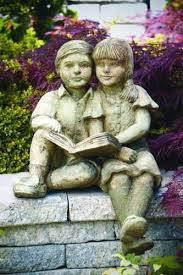 boy and girl reading sculpture
