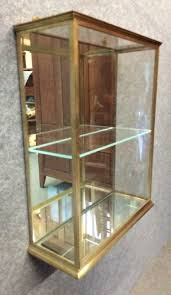 wall mounted brass display cabinet