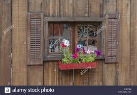 Wood Fence With Window And Flower Box With Flowers Shot For Screen Stock Photo Alamy
