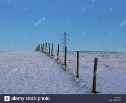 Fence Posts Across A Field In A Snow Covered Landscape On Dunstable Downs Bedfordshire England Uk Stock Photo Alamy