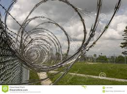Prison Yard Fencing With Razor Wire Stock Image Image Of Close Neglect 118174803
