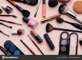 makeup set on pink background top view