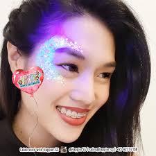 uv glitter festival makeup
