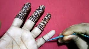 mehndi design in fingers in front