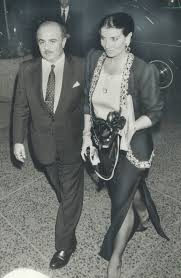 Night out on the town: Arab tycoon Adnan Khashoggi and his wife Lamia  arrive at the King Edward Hotel last night after dinner. The  multi-billionaire is in Ontario to make business contacts. :