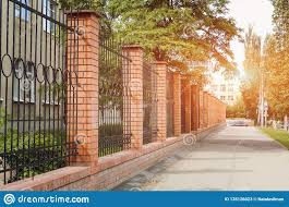 Brick And Metal Fence With Door And Gate Of Modern Style Design In The Setting Sun Metal Fence Ideas Stock Image Image Of Bushes Architecture 135126023