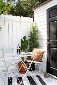 Balcony With White Wooden Flooring White High Vertical Wooden Fence Of Adding More Privacy To The Balcony Small Yard Deck Design Small Deck Designs